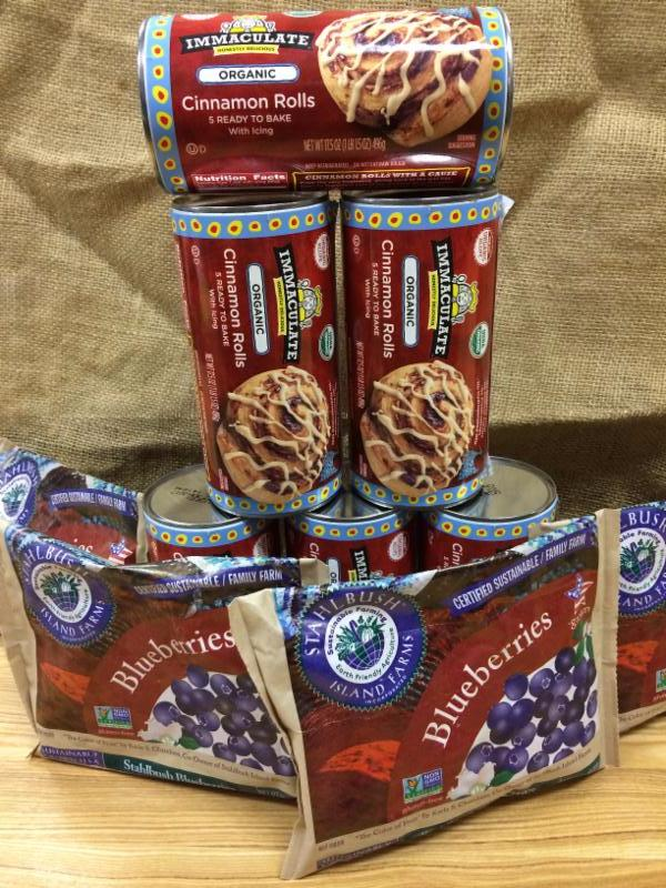 A tower of cinnamon roll tubes and packages blueberries
